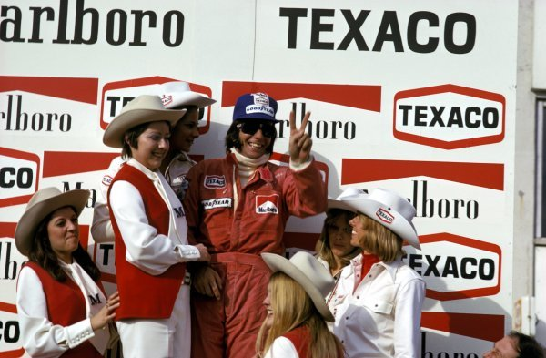 Emerson Fittipaldi (BRA) McLaren celebrates his victory on the podium. Belgian Grand Prix, Nivelles-Baulers, 12 May 1974. BEST IMAGE