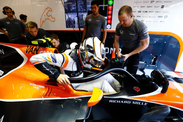Spa Francorchamps, Belgium.  Friday 25 August 2017. Stoffel Vandoorne, McLaren, enters his cockpit, which is fitted with a halo device. World Copyright: Steven Tee/LAT Images  ref: Digital Image _O3I0442