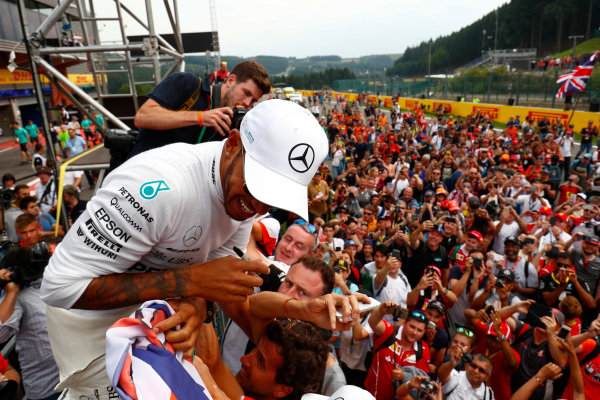 Spa Francorchamps, Belgium.  Sunday 27 August 2017. Lewis Hamilton, Mercedes AMG, 1st Position, celebrates with fans after the race. World Copyright: Sam Bloxham/LAT Images  ref: Digital Image _W6I1757