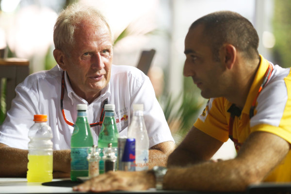 Marina Bay Circuit, Singapore. Saturday 19 September 2015. Helmut Markko, Consultant, Red Bull Racing, with Cyril Abiteboul, Head Engineer, Renault Sport F1. World Copyright: Alastair Staley/LAT Photographic ref: Digital Image _R6T6077