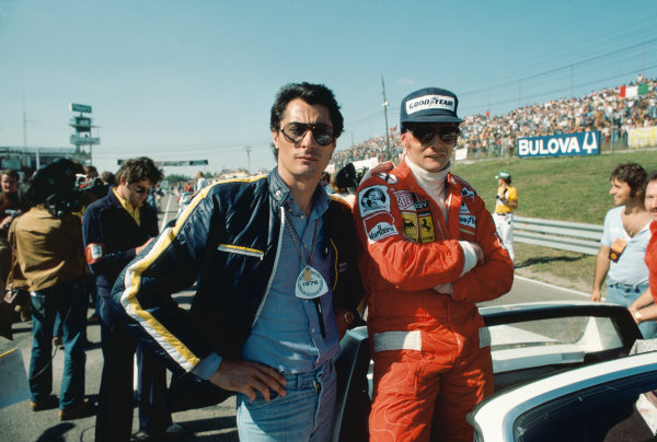 Mosport Park, Ontario, Canada. 1st - 3rd October 1976. Niki Lauda (Ferrari 312T2), 8th position with Ferrari team manager, Daniele Audetto on the grid, portrait.  World Copyright: Murenbeeld/LAT Photographic. Ref:  76 CAN 17.
