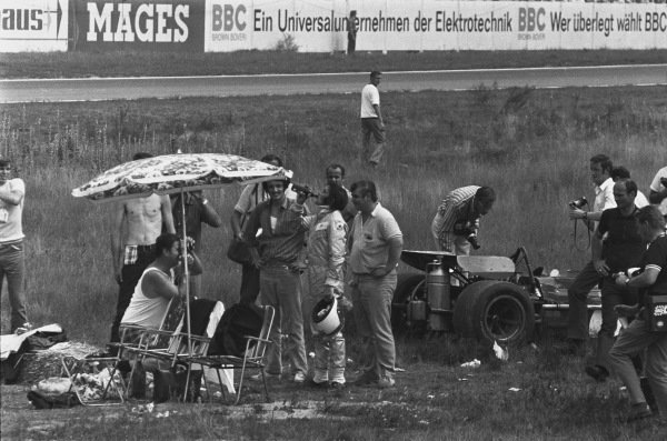 1970 German Grand Prix. Hockenheim, Germany. 31st July - 2nd August 1970. Jackie Stewart (March 701-Ford), 2nd position, stops and has a drink at a marshalls post during practice, portrait.  World Copyright: LAT Photographic. Ref: 1324C - 17A.