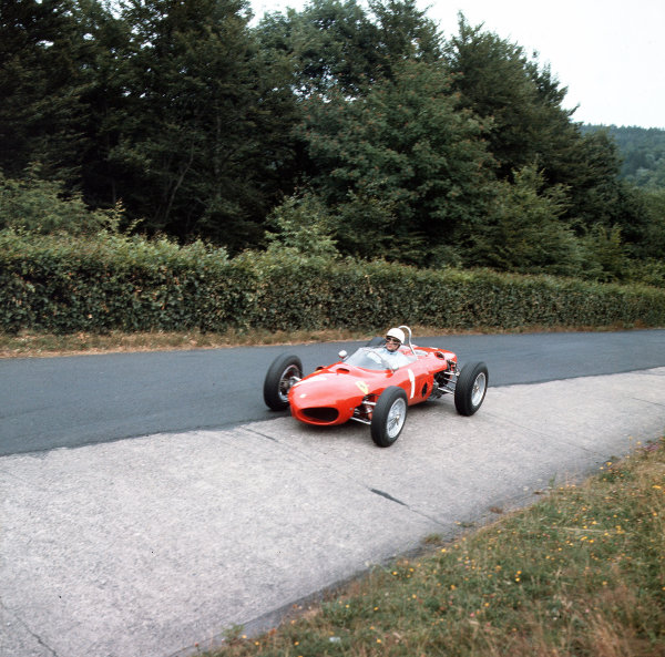 Nurburgring, Germany.3-5 August 1962.Phil Hill (Ferrari Dino 156) at the Karussell.Ref-3/0638.World Copyright - LAT Photographic