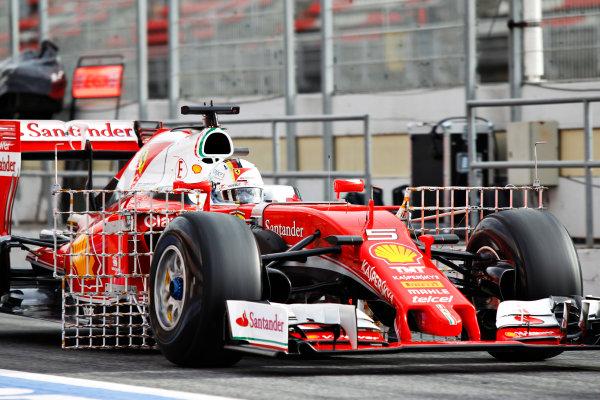 Circuit de Catalunya, Barcelona, Spain Monday 22 February 2016. Sebastian Vettel, Ferrari SF16-H, in the pit lane. World Copyright: Sam Bloxham/LAT Photographic ref: Digital Image _G7C0486