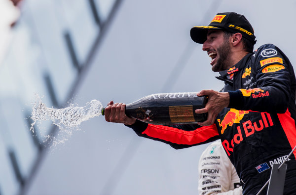 Red Bull Ring, Spielberg, Austria. Sunday 9 July 2017. Daniel Ricciardo, Red Bull Racing, 3rd Position, sprays Champagne on the podium. World Copyright: Zak Mauger/LAT Images ref: Digital Image _56I5183