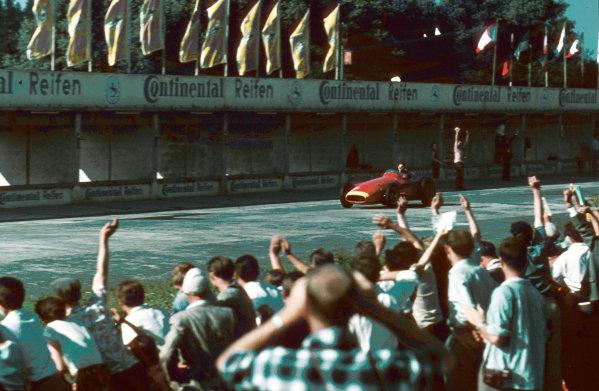 Nurburgring, Germany. 2-4 August 1957.Juan Manuel Fangio (Maserati 250F) 1st position. Ref-57 GER 21.World Copyright - Tony Smythe/LAT Photographic