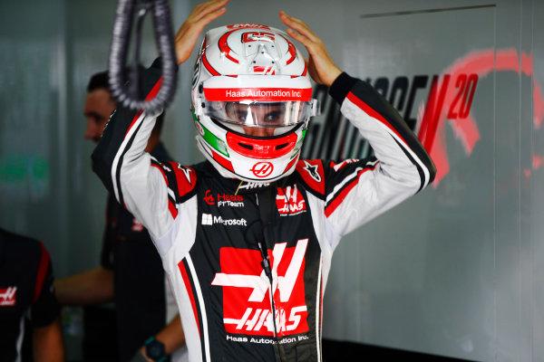 Sepang International Circuit, Sepang, Malaysia. Friday 29 September 2017. Antonio Giovinazzi, Haas F1 Team, adjusts his helmet ahead of FP1. World Copyright: Andy Hone/LAT Images  ref: Digital Image _ONY1370