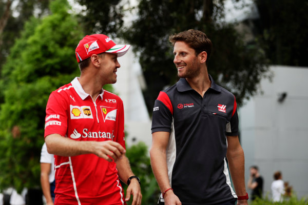Sepang International Circuit, Sepang, Malaysia. Friday 29 September 2017. Sebastian Vettel, Ferrari, with Romain Grosjean, Haas F1.  World Copyright: Zak Mauger/LAT Images  ref: Digital Image _56I2287
