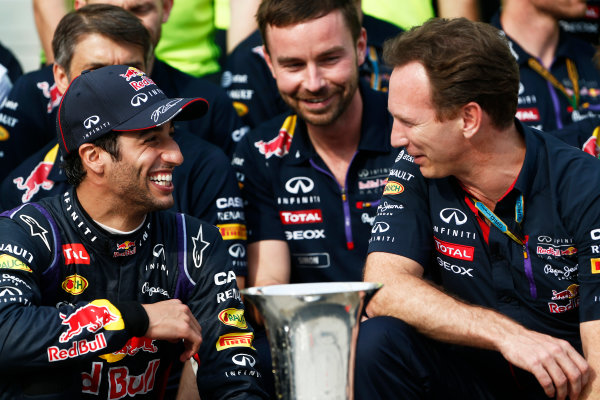 Hungaroring, Budapest, Hungary. Sunday 27 July 2014. Daniel Ricciardo, Red Bull Racing, 1st Position, and Christian Horner, Team Principal, Red Bull Racing, celebrate with their team. World Copyright: Sam Bloxham/LAT Photographic. ref: Digital Image _SBL1317