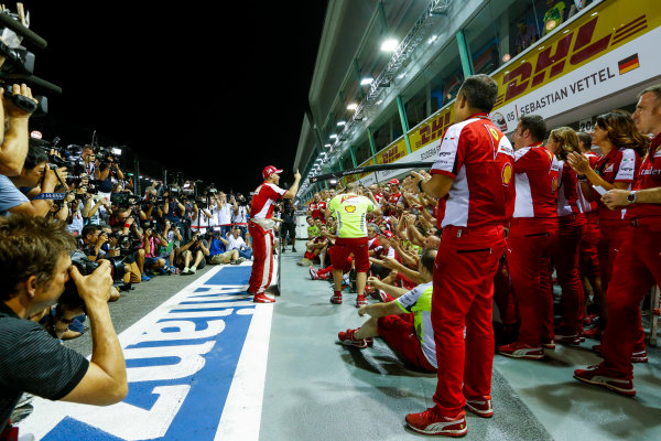 Marina Bay Circuit, Singapore. Sunday 20 September 2015. Sebastian Vettel, Ferrari, 1st Position, Kimi Raikkonen, Ferrari, 3rd Position, and the Ferrari team celebrate a double podium result. World Copyright: Alastair Staley/LAT Photographic ref: Digital Image _R6T7513