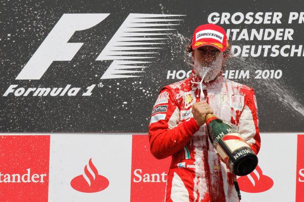 Hockenheimring, Hockenheim, Germany 25th July 2010 Fernando Alonso, Ferrari F10, 1st position, sprays the champagne on the podium. Portrait. Podium.  World Copyright: Andrew Ferraro/LAT Photographic ref: Digital Image _Q0C4576