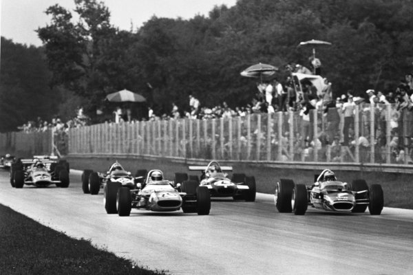 Monza, Italy. 7 September 1969.Jackie Stewart, #20 Matra MS80-Ford, 1st position, and Jochen Rindt, #4 Lotus 49B-Ford, 2nd position, lead Piers Courage, Brabham BT26-Ford, 5th position, Jo Siffert, Lotus 49B-Ford, 8th position, and Bruce McLaren, McLaren M7C-Ford, 4th position, action.World Copyright: LAT PhotographicRef: Motor b&w print