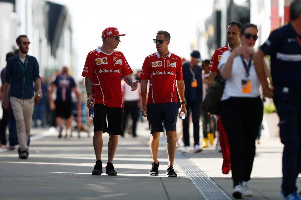 Hungaroring, Budapest, Hungary.  Friday 28 July 2017. Kimi Raikkonen, Ferrari, and Sebastian Vettel, Ferrari. World Copyright: Glenn Dunbar/LAT Images  ref: Digital Image _31I8992