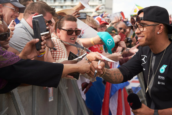 Silverstone Circuit, Northamptonshire, England. Saturday 4 July 2015. Lewis Hamilton, Mercedes AMG, signs autographs for fans. World Copyright: Steve Etherington/LAT Photographic ref: Digital Image SNE18850