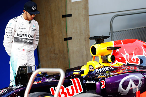 Shanghai International Circuit, Shanghai, China. Saturday 11 April 2015. Lewis Hamilton, Mercedes AMG, inspects the car of Daniel Ricciardo, Red Bull Racing RB11 Renault, in Parc Ferme. World Copyright: Charles Coates/LAT Photographic. ref: Digital Image _J5R9467