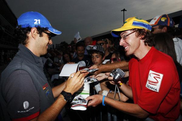 Bruno Senna (BRA) Hispania Racing F1 Team (HRT) signs autographs for the fans. Formula One World Championship, Rd 14, Italian Grand Prix, Preparations, Monza, Italy, Thursday 9 September 2010.  BEST IMAGE