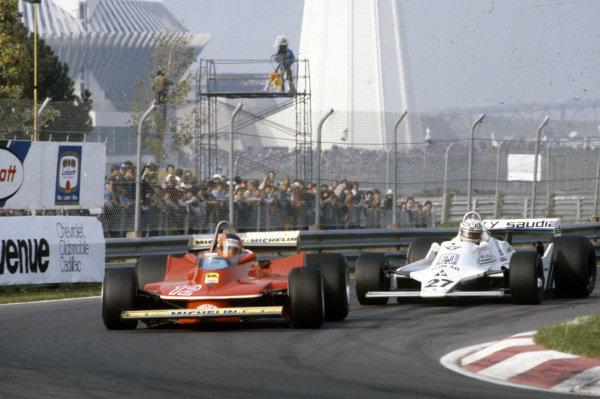 Gilles Villeneuve, Ferrari 312T4 leads Alan Jones, Williams FW07 Ford.