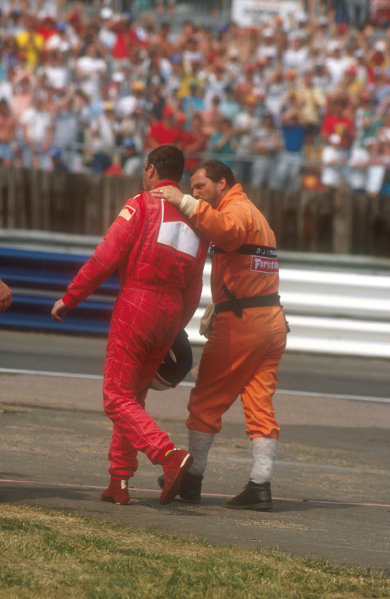 1990 British Grand Prix.Silverstone, England.13-15 July 1990.Nigel Mansell (Ferrari) retires. He was leading the race when his gearbox began to malfunction, until finally on lap 55 it failed completely.Ref-90 GB 01.World Copyright - LAT Photographic