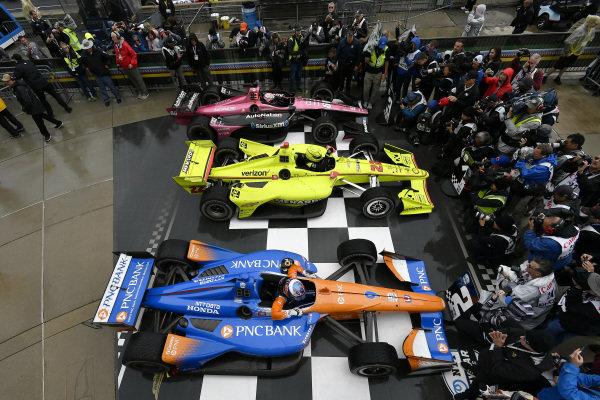 Scott Dixon, Chip Ganassi Racing Honda, Simon Pagenaud, Team Penske Chevrolet, Jack Harvey, Meyer Shank Racing in victory lane