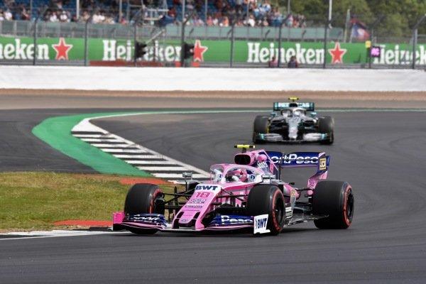 Lance Stroll, Racing Point RP19, leads Valtteri Bottas, Mercedes AMG W10