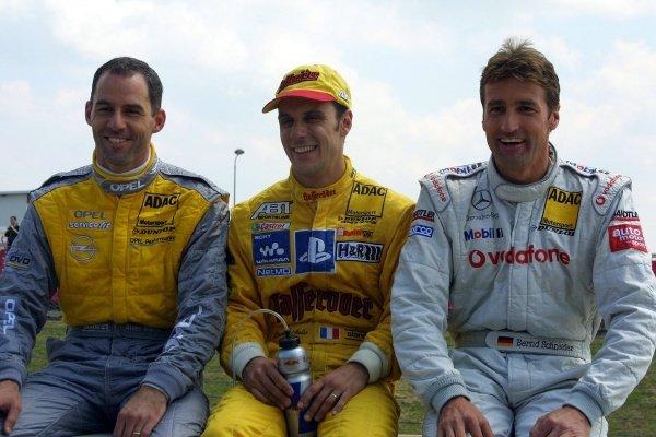 L-R: Alain Menu (SUI), 3rd place, Laurent Aiello (FRA) winner, Bernd Schneider (GER), 2nd place.German Touring Car Championship, Sachsenring, Germany, 2 June 2002DIGITAL IMAGE