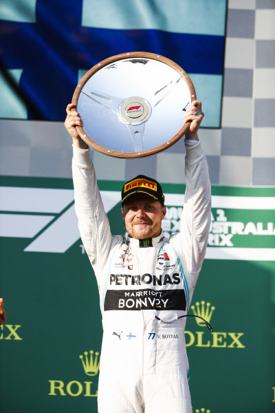 Race winner Valtteri Bottas, Mercedes AMG F1 on the podium with the trophy