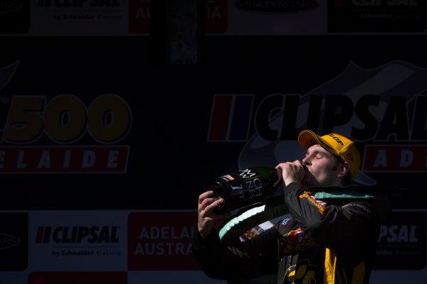 2013 V8 Supercar Championship. Round 1. Clipsal 500, Adelaide. 3rd March 2013. Sunday Race 2. Shane van Gisbergen (VIP Petfoods/Tekno Autosports – Holden Commodore VF) celebrates on the podium. Portrait.  World Copyright:  Daniel Kalisz/LAT Photographic Ref: Digital Image DKAL7500.jpg .
