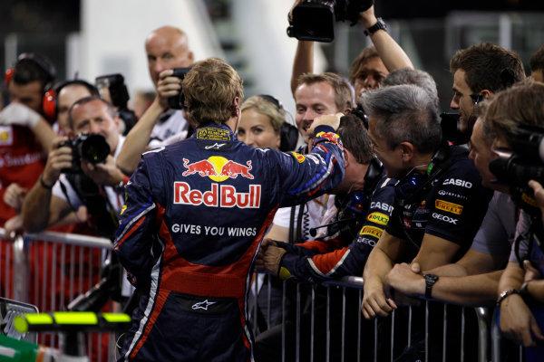Yas Marina Circuit, Abu Dhabi, United Arab Emirates12th November 2011.Sebastian Vettel, Red Bull Racing RB7 Renault, celebrates pole in Parc Ferme. Portrait. World Copyright:Glenn Dunbar/LAT Photographic ref: Digital Image _G7C4537