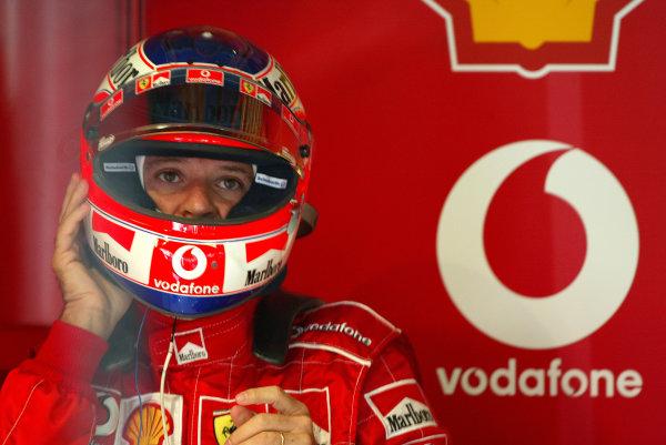 2004 Italian Grand Prix - Friday Practice,Monza, Italy. 10th September 2004 Rubens Barrichello, Ferrari F2004, wearing helmet.World Copyright: Steve Etherington/LAT Photographic ref: Digital Image Only