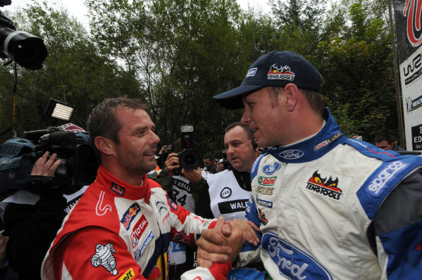 Sebastien Loeb (FRA) and Petter Solberg (NOR) at the end of stage 19.