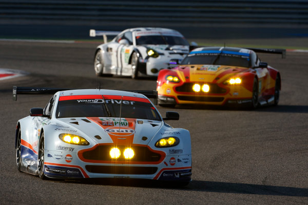 2015 FIA World Endurance Championship Bahrain 6-Hours Bahrain International Circuit, Bahrain Saturday 21 November 2015. Christoffer Nygaard, Marco S?rensen, Nicki Thiim (#95 GTE PRO Aston Martin Racing Aston Martin Vantage V8) leads Alex MacDowall, Fernando Rees, Richie Stanaway (#99 GTE PRO Aston Martin Racing Aston Martin Vantage V8) an Patrick Pilet, Fr?d?ric Makowiecki (#92 GTE PRO Porsche AG Team Manthey Porsche 911 RSR). World Copyright: Alastair Staley/LAT Photographic ref: Digital Image _79P0051