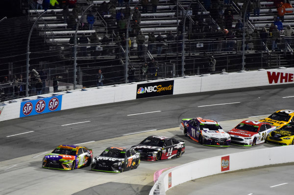 Monster Energy NASCAR Cup Series First Data 500 Martinsville Speedway, Martinsville VA USA Sunday 29 October 2017 Kyle Busch, Joe Gibbs Racing, M&M's Halloween Toyota Camry wins as Denny Hamlin, Joe Gibbs Racing, FedEx Walgreens Toyota Camry and Ryan Blaney, Wood Brothers Racing, Motorcraft/Quick Lane Tire & Auto Center Ford Fusion wreck World Copyright: Nigel Kinrade LAT Images