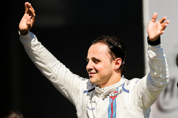 Interlagos, Sao Paulo, Brazil. Sunday 12 November 2017. Felipe Massa, Williams Martini Racing, waves from the podium whilst celebrating after his final home Grand Prix. World Copyright: Charles Coates/LAT Images  ref: Digital Image AN7T7648