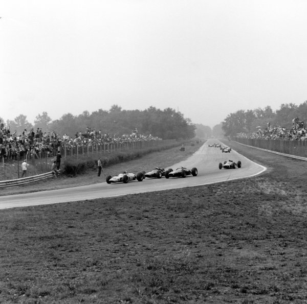 1964 Italian Grand Prix.Monza, Italy. 6 September 1964.Innes Ireland, BRP 2-BRM, 5th position, leads Lorenzo Bandini, Ferrari 158, 3rd position, Richie Ginther, BRM P261, 4th position, and Jo Bonnier, Brabham BT7-Climax, 12th position, action.World Copyright: LAT PhotographicRef: 26655