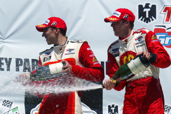The podium: Justin Wilson (GBR) RuSPORT 2nd and Sebastien Bourdais (FRA) 1st 