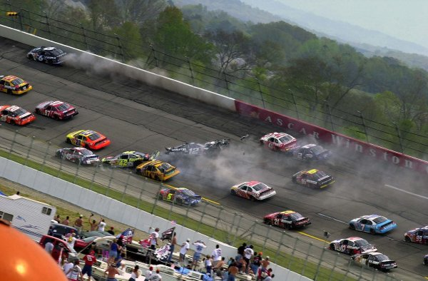 "NASCAR Winston Cup Aaron's 499, Talladega Superspeedway, Talladega,Alabama, USA 6 April,2003Ryan Newman (#12) sets off ""The Big Crash"" after cutting a tire in turn one.-Lori M. Spitler/LAT Photographic 2003"
