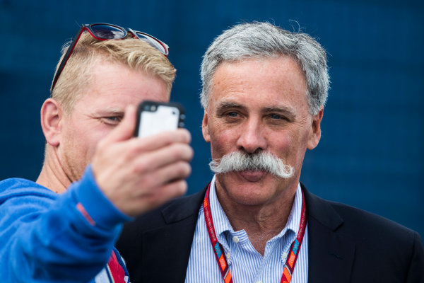 Silverstone, Northamptonshire, UK.  Friday 14 July 2017. A fan gets a photo with Chase Carey, Chairman, Formula One. World Copyright: Malcolm Griffiths/LAT Images  ref: Digital Image MALC2049