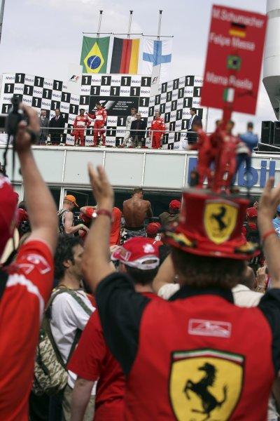 2006 German Grand Prix - Sunday Race Hockenheim, Germany. 27th - 30th July. Ferrari fans get a good view of the podium. World Copyright: Charles Coates/LAT Photographic ref: Digital Image ZK5Y2445