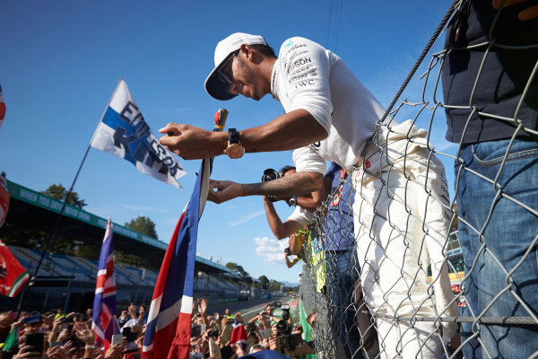 Autodromo Nazionale di Monza, Italy. Sunday 3 September 2017. Lewis Hamilton, Mercedes AMG, signs autographs for fans. World Copyright: Steve Etherington/LAT Images  ref: Digital Image SNE15509