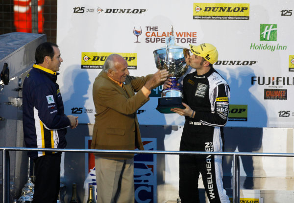 2013 British Touring Car Championship.  Round 10 - Brands Hatch, Kent.  Brands Hatch, 12th-13th October 2013.  Lea Wood, Wood Vauxhall, receives the Jack Sears Trophy from Jack Sears himself.  Ref: _MG_8783a. World copyright: Kevin Wood/LAT Photographic
