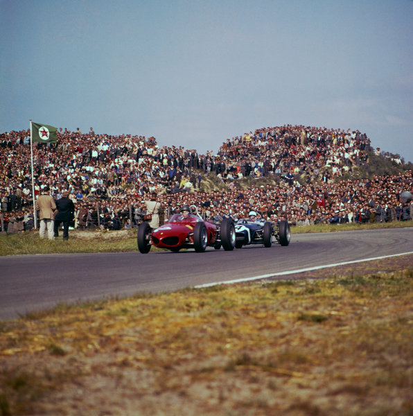 Zandvoort, Holland. 20-22 May 1961.Richie Ginther (Ferrari Dino 156) leads Stirling Moss (Lotus 18-Climax). They finished in 5th and 4th position respectively, action.World Copyright: LAT PhotographicRef: 274.