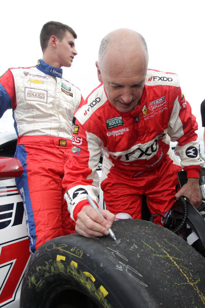 16-18 August, 2012, Montreal, Quebec, CanadaDriver Emil Assentato autographs a racing tire for a fan in the paddock.(c)2012, R D. EthanLAT Photo USA