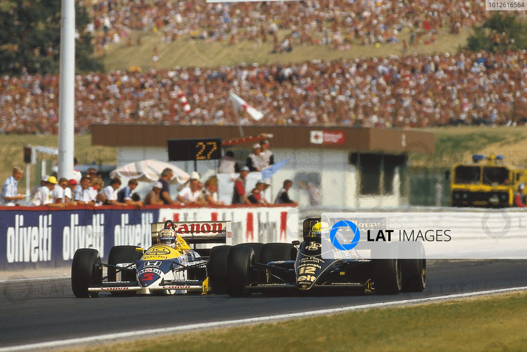 Hungaroring, Budapest, Hungary.8-10 August 1986.Ayrton Senna (Lotus 98T Renault) overtakes Nigel Mansell (Williams FW11 Honda). They finished in 2nd and 3rd positions respectively.Ref-Motorsport Catalogue p 29, 86 HUN 11.Please Note: This image is available as a 30mb+ CMYK Tiff scan upon request.World Copyright - LAT Photographic