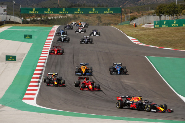 Max Verstappen, Red Bull Racing RB16B, leads Carlos Sainz, Ferrari SF21, Sergio Perez, Red Bull Racing RB16B, Esteban Ocon, Alpine A521 Lando Norris, McLaren MCL35M, Charles Leclerc, Ferrari SF21, and the remainder of the field