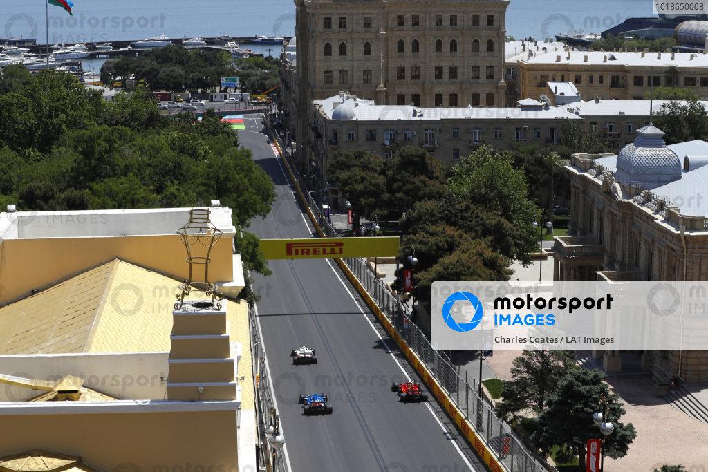 Mick Schumacher, Haas VF-21, leads Charles Leclerc, Ferrari SF21, and Esteban Ocon, Alpine A521