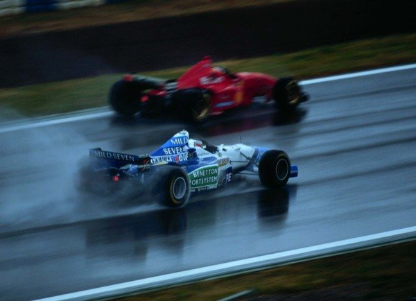 1996 Spanish Grand Prix.Catalunya, Barcelona, Spain.31/5-2/6 1996.Michael Schumacher (Ferrari F310) overtakes Gerhard Berger (Benetton B196-Renault). He finished in 1st position.World Copyright - LAT Photographic