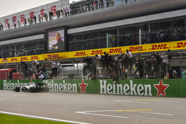 Lewis Hamilton, Mercedes AMG F1 W10, 1st position, passes the Mercedes pit wall at the end of the race