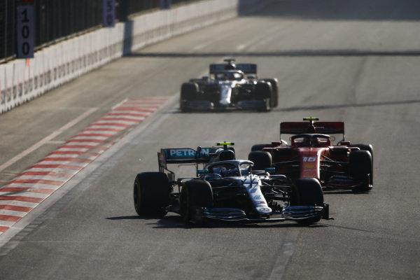 Valtteri Bottas, Mercedes AMG W10, leads Charles Leclerc, Ferrari SF90, and Lewis Hamilton, Mercedes AMG F1 W10