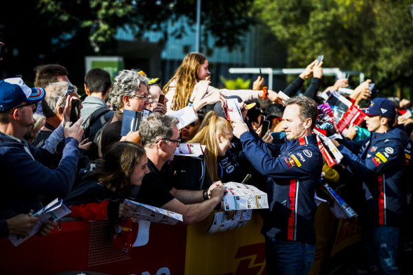 Christian Horner, Team Principal, Red Bull Racing and Pierre Gasly, Red Bull Racing sign autographs for fans at the Federation Square event
