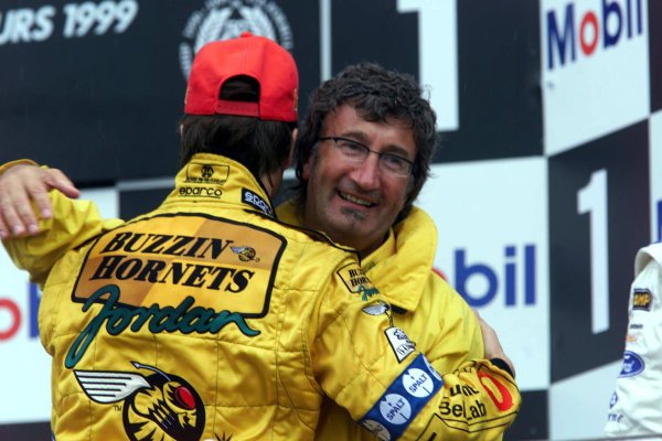 1999 French Grand Prix.Magny-Cours, France.25-27 June 1999. Heinz-Harald Frentzen (Jordan Mugen Honda) celebrates a fine victory on the podium with team boss Eddie Jordan. World Copyright - Lawrence/LAT Photographic